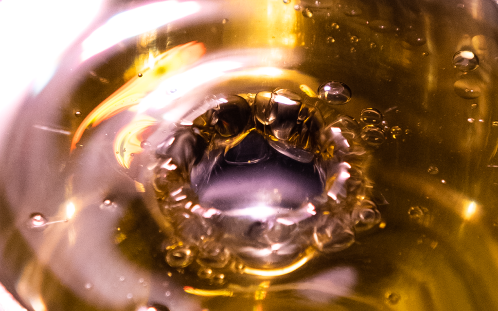 water droplets through olive oil.